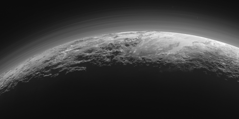 Pluto's atmosphere is as foggy as Titan, but for a different reason