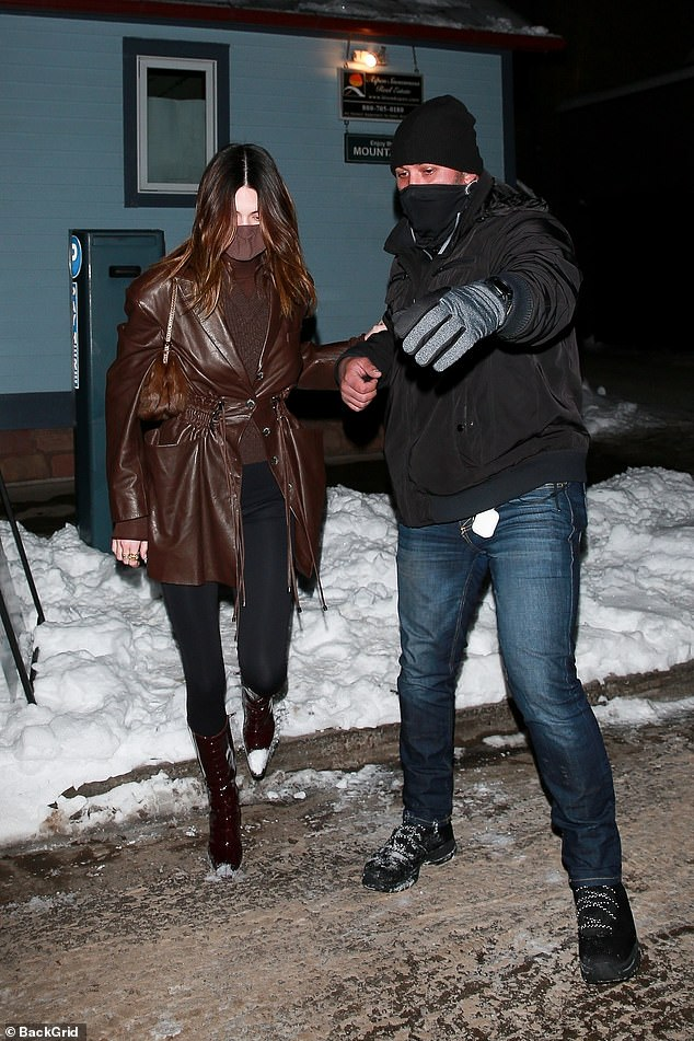 Helping Hand: An assistant guides Kendall to their waiting car