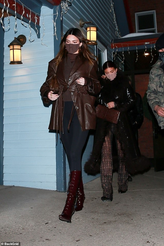Here come the girls!  The respected 25-year-old model led the way in a stunning brown look, while her plastic big sister, 23, and mother Momagger, 64, chose stylish black coats, while Chris's boyfriend Corey Gamble was on a hot pursuit.
